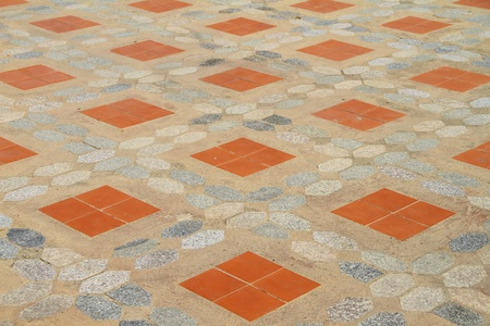 Cement floor tiles laid with orange  photo