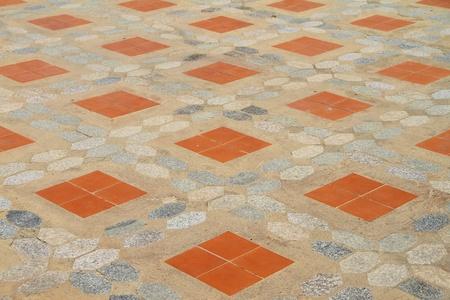 Cement floor tiles laid with orange  photo