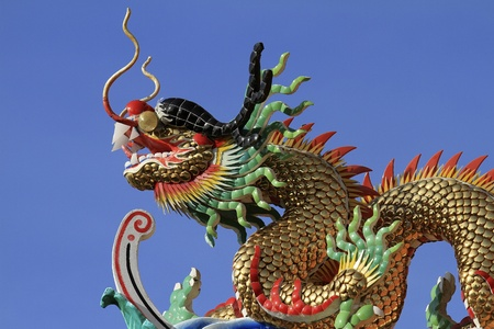 Dragon statue against a backdrop of sky Stock Photo - 10637069