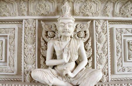 Hermit cement statue that looks white.  photo