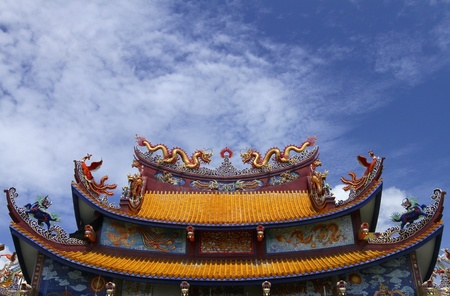 Chinese temple roof with a background of sky  photo