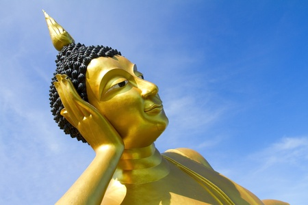veneration: Big Buddha Image of the sky against a backdrop of Wat Thai in Thailand