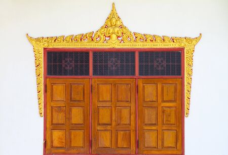 Three wooden window pane Wat Thai.  photo