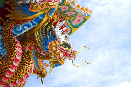 chinese new year dragon: statue dragon on blue sky background