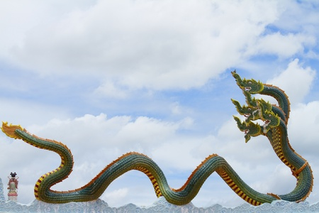 Four-headed serpent on a Chinese temple roof.  photo
