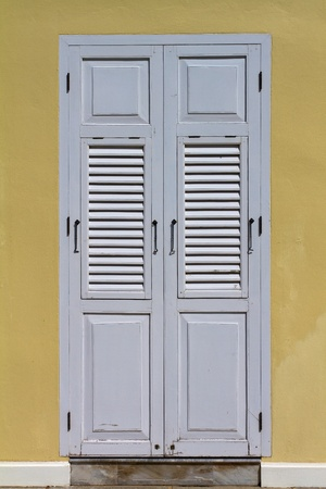 view of a wooden doorway: White wooden door
