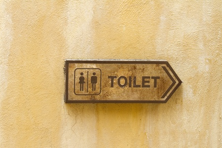 Toilet logo with orange color wall background  photo