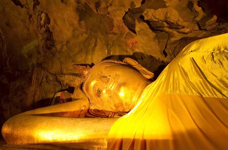 Reclining Buddha in a cave Khao Luang, Petchaburi Province, Thailand  Stock Photo - 13895842
