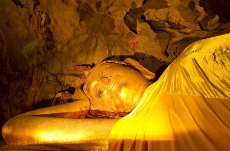 Reclining Buddha in a cave Khao Luang, Petchaburi Province, Thailand Stock Photo - 13895842