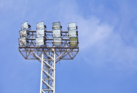 Stadium floodlight against blue sky photo