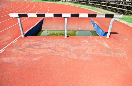 Hurdle and Curve of Race Track in Stadium photo
