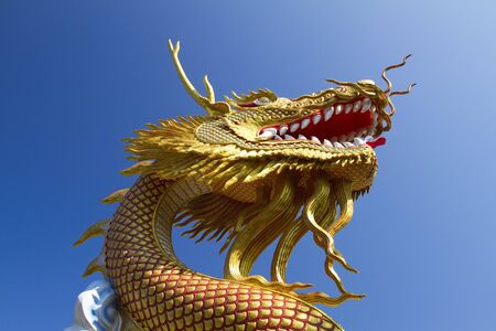 replica: Golden Dragon with the backdrop of the sky  Stock Photo