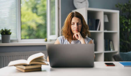 Woman using laptop for work