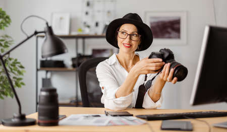 Female photographer at office