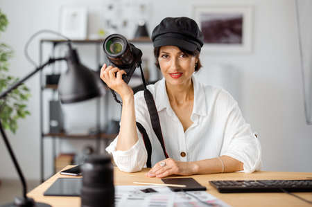 Photographer with camera at office
