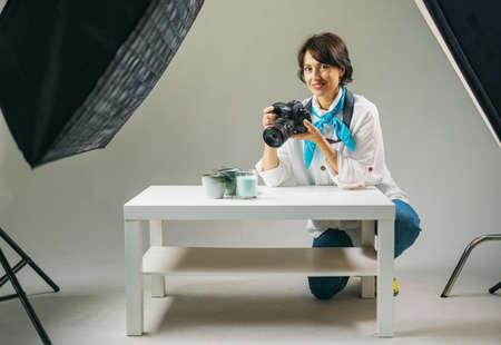 Photographer taking creative photos at studio