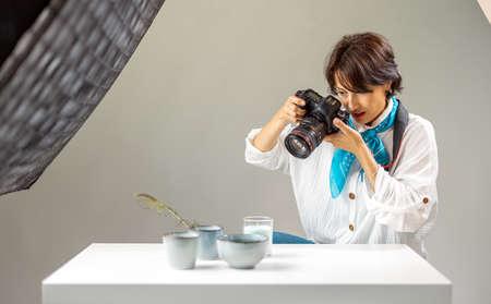 Woman shooting at studio