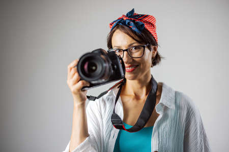 Photographer with camera at studio