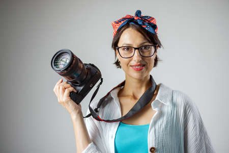 Woman with photo camera indoors