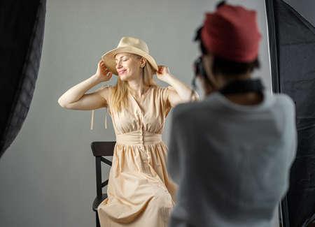 Female photographer shooting model