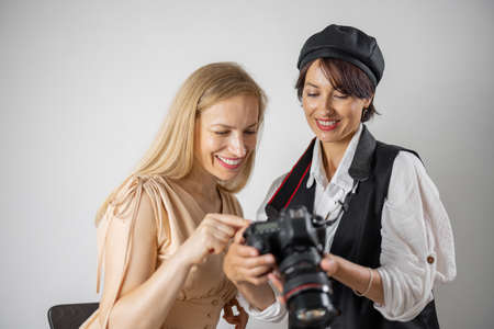 Photographer showing photos to model