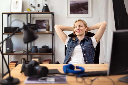 Female photographer resting at office 版權商用圖片