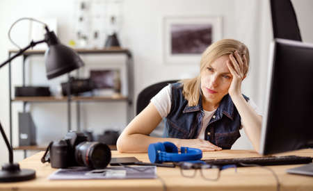 Exhausted photographer at office