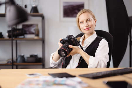 Thoughtful photographer at office