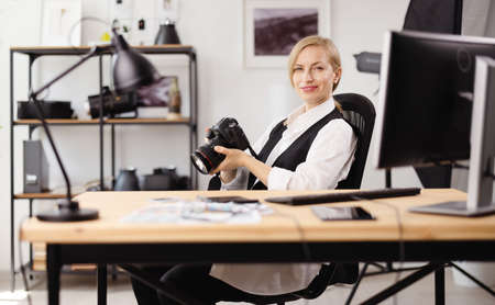 Photographer sitting at office