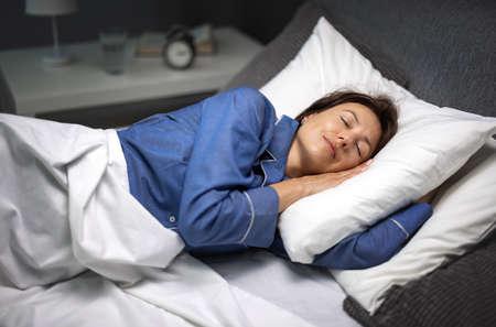 Woman sleeping at night 版權商用圖片