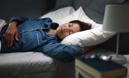 Woman sleeping sweet at night 版權商用圖片