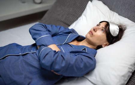 Sleepless woman in bed 版權商用圖片