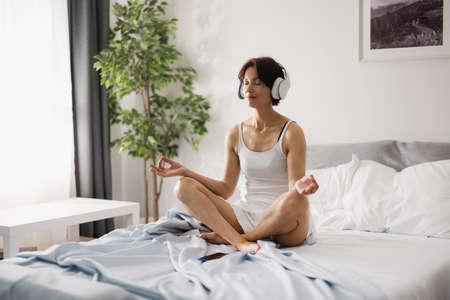 Woman in headphones morning meditation 版權商用圖片