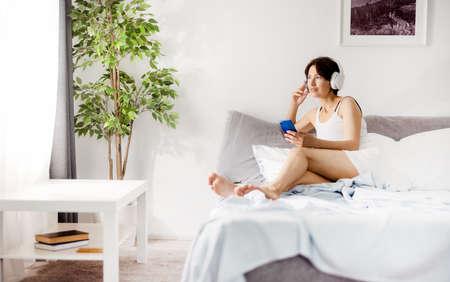 Woman enjoying music during morning
