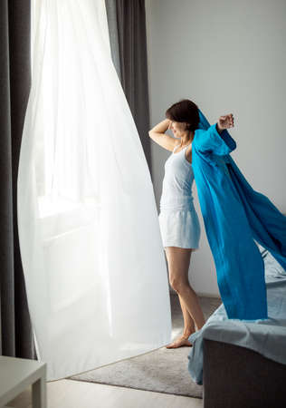 Woman near window during morning