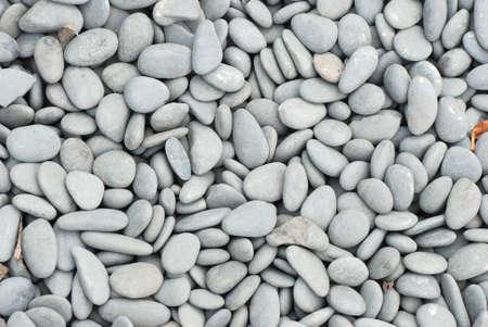black pebbles: Cobblestone background road close up Stock Photo