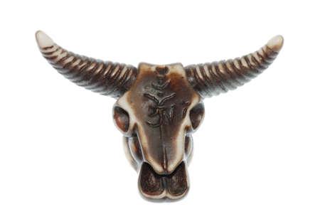 daimon bull skull isolated in white background. photo