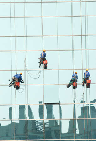 window clean worker on office building photo