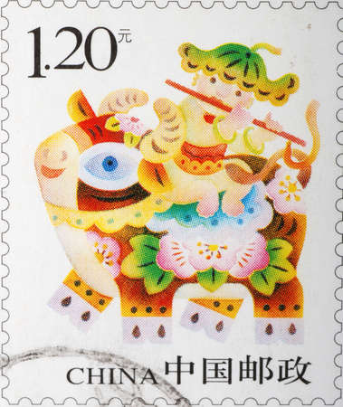 chinese postage stamp: China - CIRCA 2009: A stamp printed in China shows a Chinese kid on buffalo, circa 2009 Stock Photo