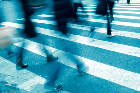 action blur: Busy big city street people on zebra crossing