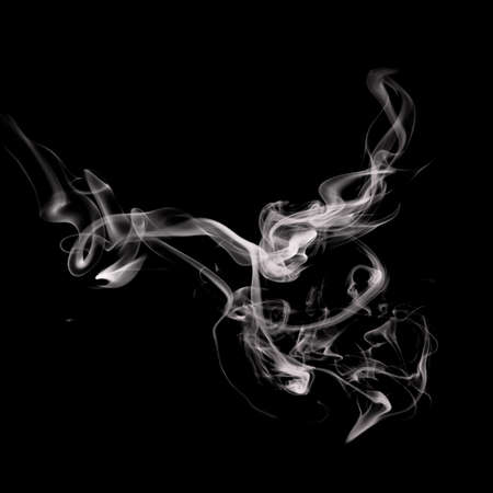 Abstract smoke isolated on black background photo