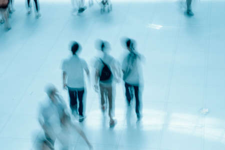 abstract business people rushing in the lobby blur motion photo