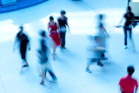 abstract business people rushing in the lobby blur motion