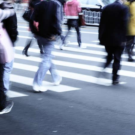 crossing street: business people on zebra crossing street