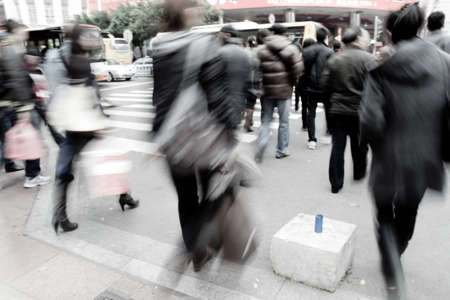rush hour: Busy big city street people on zebra crossing