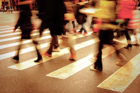 rush hour: people on zebra crossing street