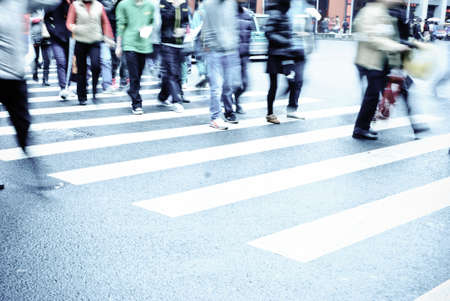 people on zebra crossing street photo