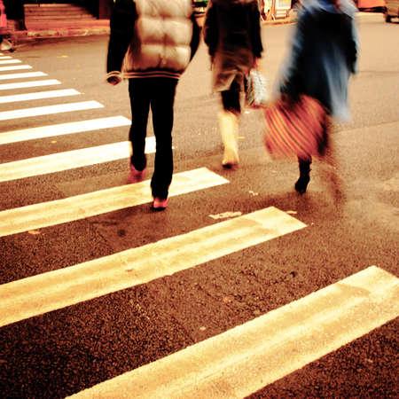 people on zebra crossing street photo