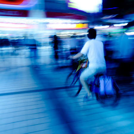 city people on bicycle blur motion photo