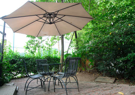 porch scene: coffee table with metallic chairs cafe outdoor Stock Photo
